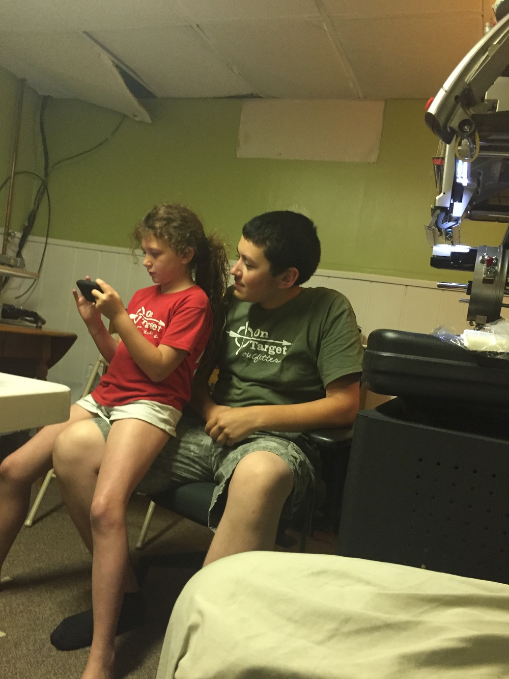 """Clayton with his """"sister""""Eliza making On Target shirts at the Isgro's house!"""