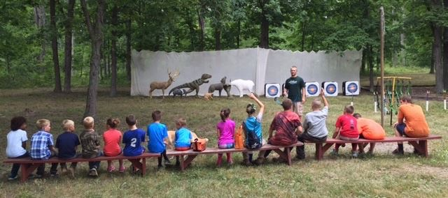 Brian teaching the new campers in Findlay about archery!