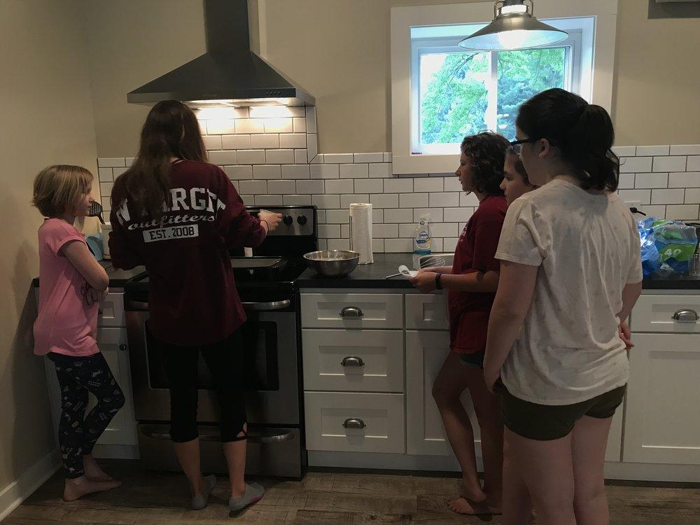 into the wild girls pancake making.JPG
