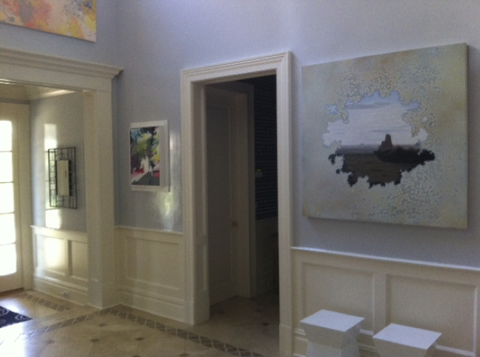 Paintings by Karen Seapker (left),  Man in Grey Flannel ; and Shane McAdams,  Chenle