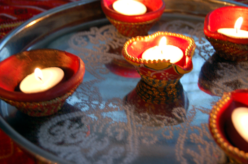 During Diwali lamps called diyas are illuminated everywhere. You can use small tealight candles instead of cotton wicks immersed in ghee.