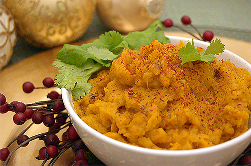 Curried Sweet Potato Mash makes for a sweet and spicy side dish on a holiday table.