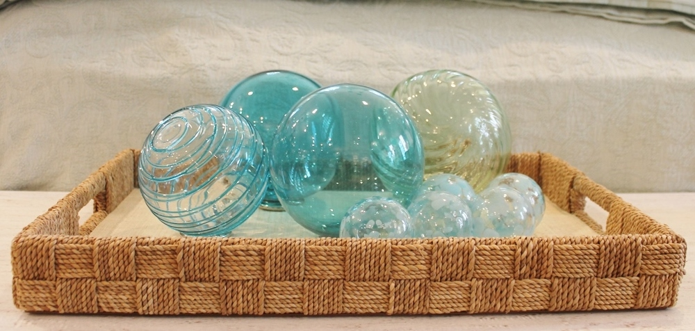 At Welch Company: A collection of glass spheres in a variety of beachy blues arranged in a jute-covered tray; an effortless way to add an impact to any room.