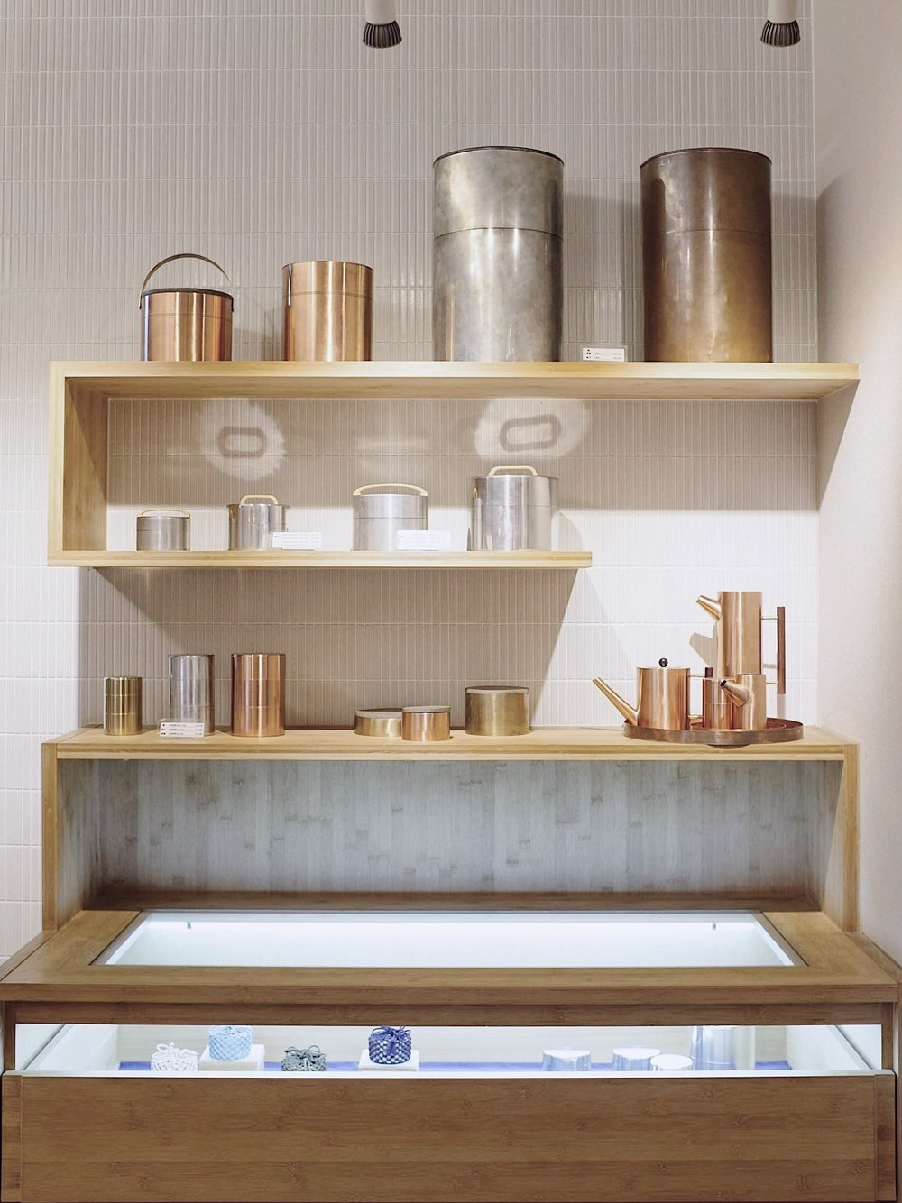 There is a multitude of different sizes and variations of Kaikado objects. Placed on the very top shelf are the oldest tea caddies with the weathered surface of the copper caddy appearing to be a deep, matte brown.