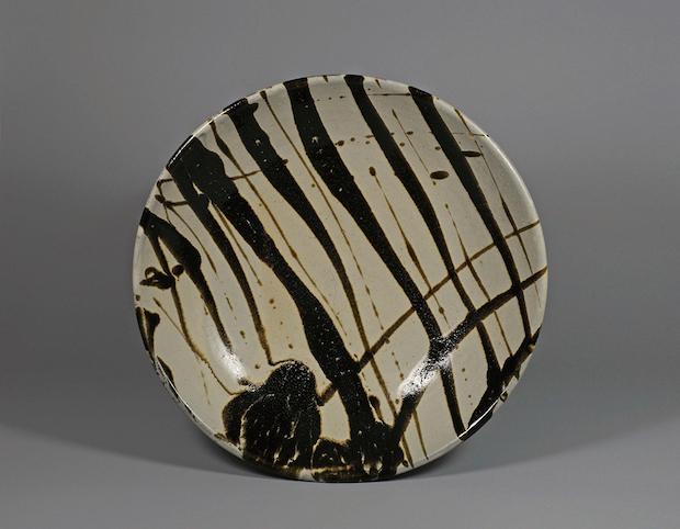 White glaze bowl with black stripped design by Shoji Hamada.  Museum of Oriental Ceramics , Osaka.