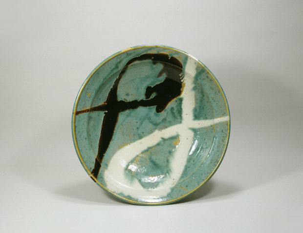 Green glazed large bowl with black and white dripping design by Shoji Hamada in 1951, now part of the  Museum of Oriental Ceramics , Osaka.