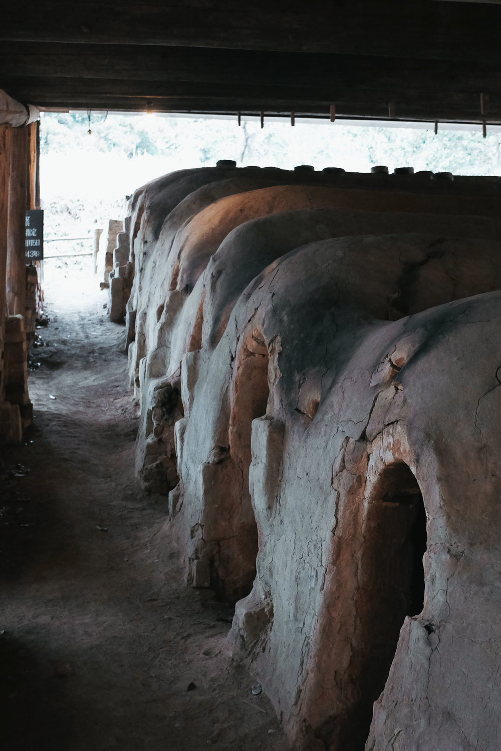 A climbing kiln 'climbs' up a slope, carrying the heat from a fire-pit below up through a series of chambers.