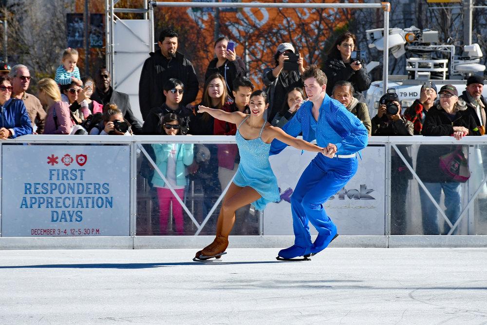 Professional skating pair Cali Fujimoto & Nick Barsi-Rhyne perform at the opening ceremony of The Winter Park at Civic Center.