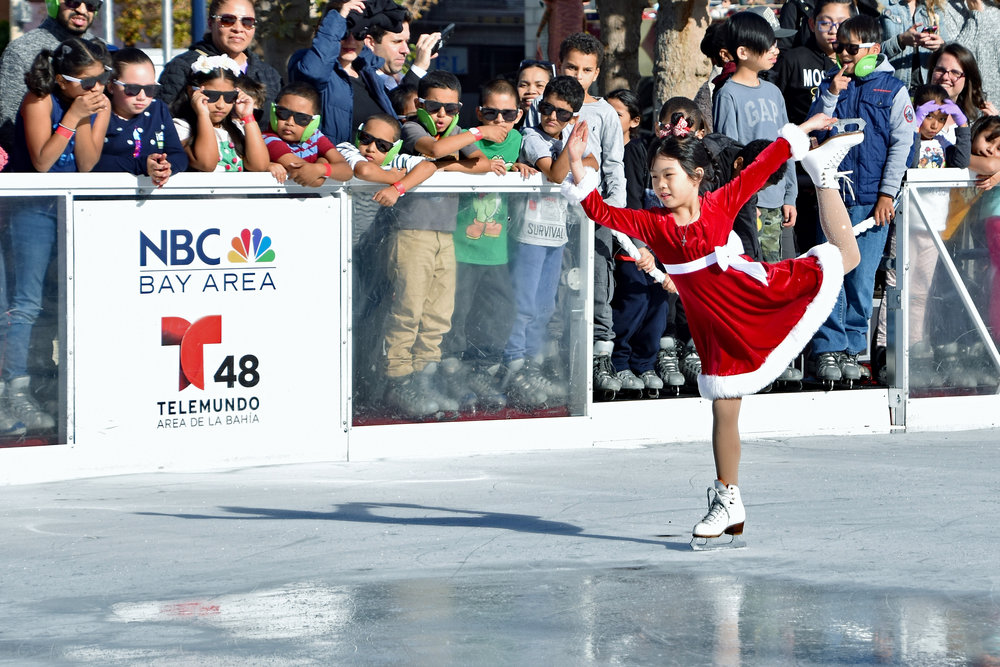 Chloe Lee of the Yerba Buena Ice Skating Center performs at the opening ceremony of The Winter Park at Civic Center.