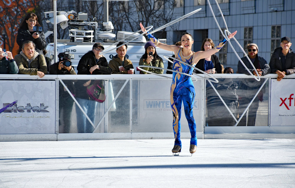 """International """"ice-hooping"""" performer Mayumi Namikoshi peforms at the opening ceremony of The Winter Park at Civic Center."""