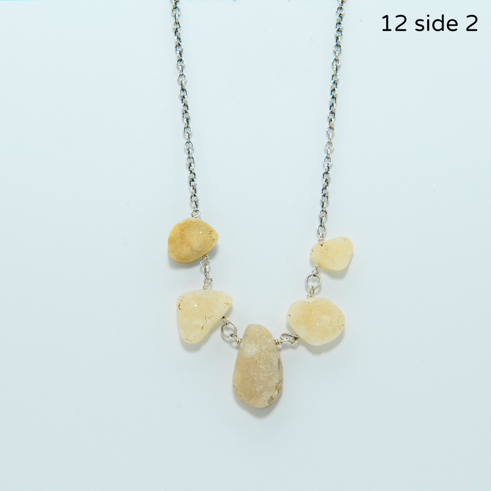 This ocean jasper drusy necklace is reversible. These gorgeous stones can be worn to show their creamy crystal side or their intriguing ocean jasper side. Necklace measures just over 16 inches in length.   $148