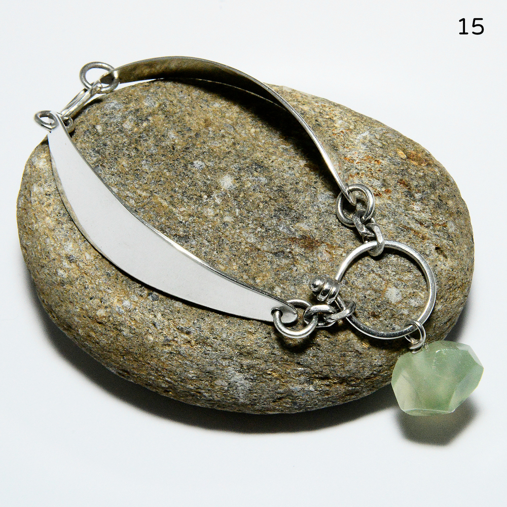 "Two sterling hinged ""leaves"" and a gorgeous prehnite stone that dangles (and stays put!) on the outside of the wrist make for one of my favorite bracelet designs. Size medium.   $158"