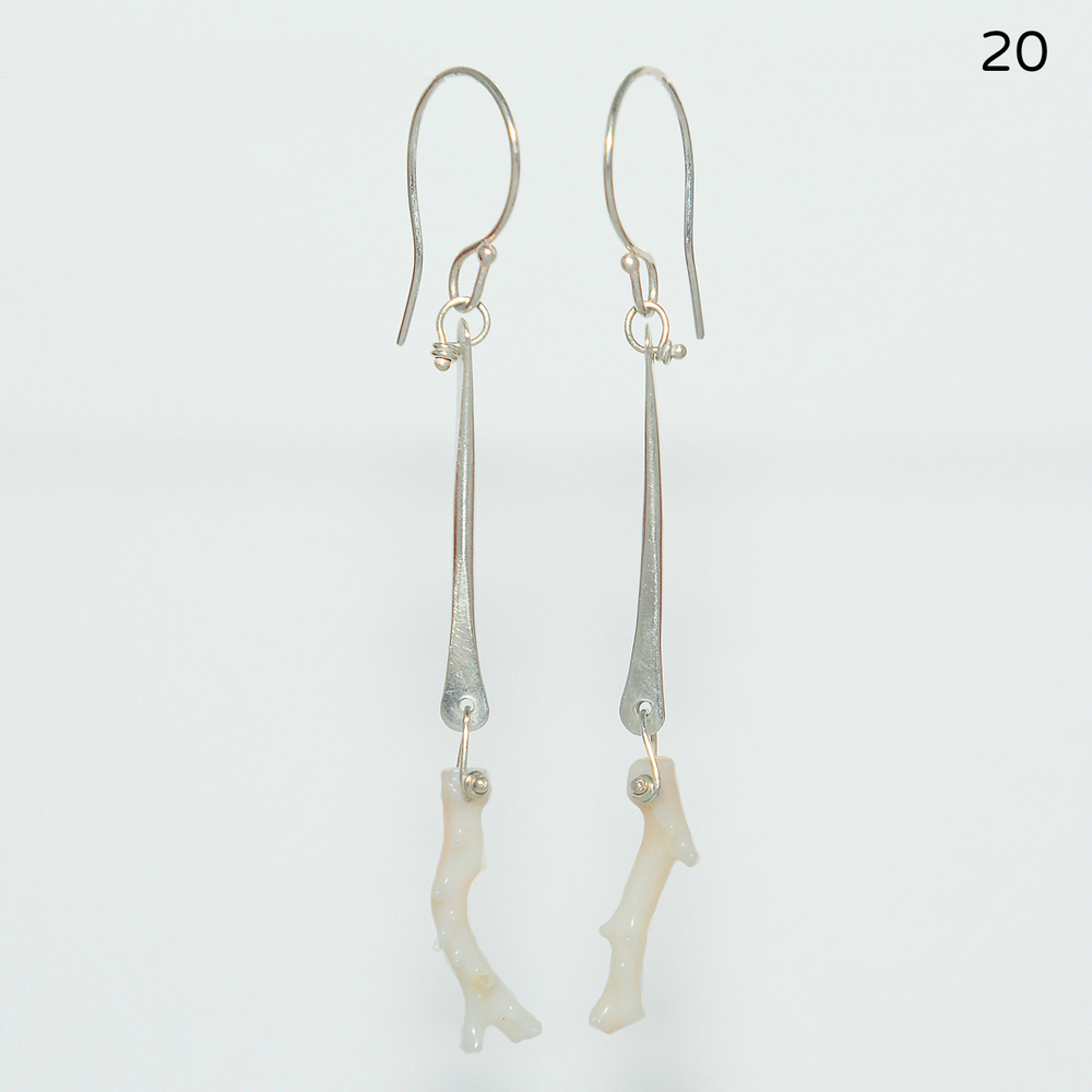 Beautiful white branch coral swings freely from hammered sterling bars on these unique earrings. These are a beautiful complement to the white coral necklace or can be worn with just about everything. Earrings hang 2 inches from the ear lobe.   $88