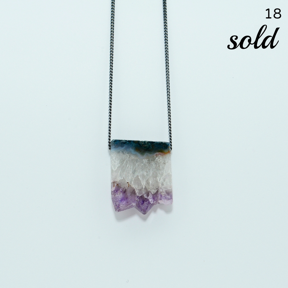 This raw amethyst crystal is suspended on a slim, oxidized chain - simple and gorgeous. Chain is 18 inches in length, and crystal in one inch by one inch.     $110