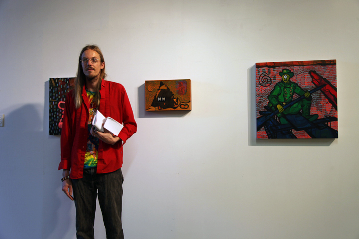 Eric in front of paintings by Paul McLean.