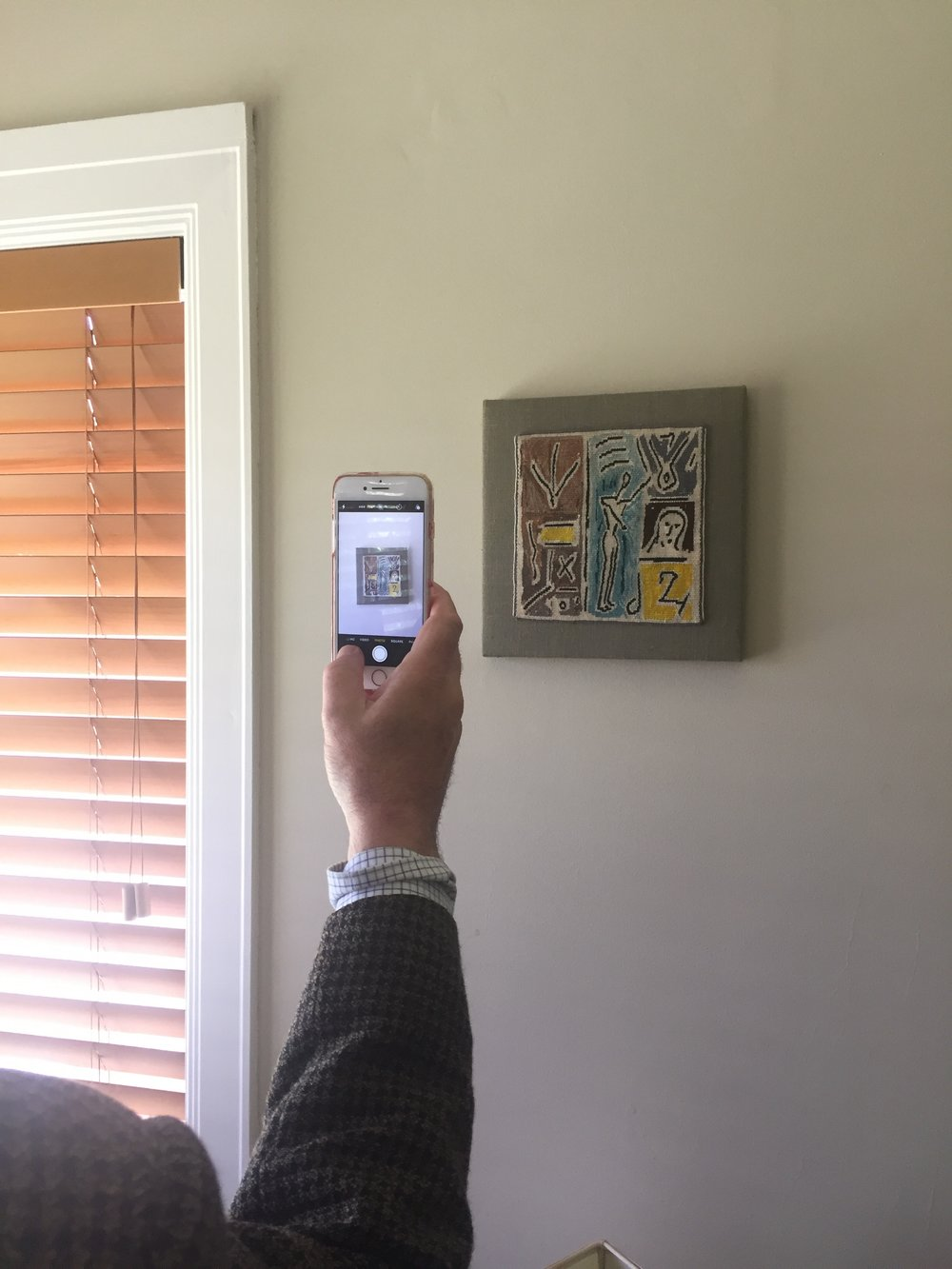 Using Art List app at home to take photos of art to record and organise.