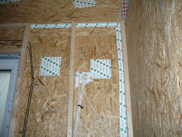 Air and vapour sealing on the inside face of the exterior wall.  A second 2x4 wall is provided for running building services to avoid penetrations in order to achieve incredibly low building envelope air changes.