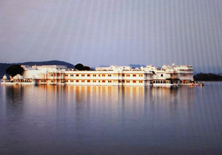 approach by boat, view majestic Lake Palace