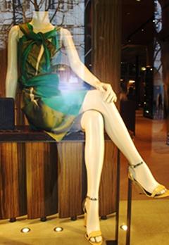 Two tone green and asymmetrical wrapping, typical Bottega Veneta.