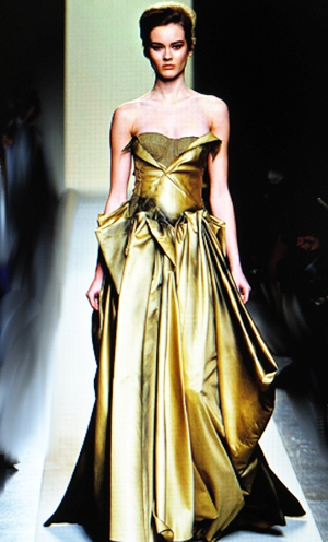 This golden gown by Bottega Veneta looked as if it was cast in liquid bronze.
