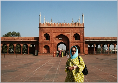 Yes, it is me under cover at the entry gate to Jama Majid the great Mosque in Old Delhi.