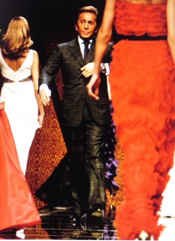Valentino on the runway with models in his favorite red.