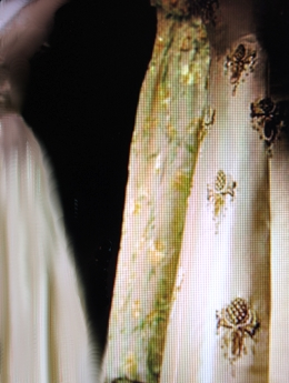 Details of gowns with thistle and other embroidery for State occasions worn by Her Majesty.