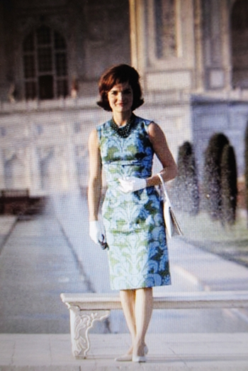 Jackie at the Taj in that famous blue and green dress standing before the bench.