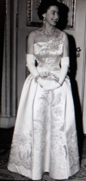 Queen Elizabeth II in an early photo wearing a splendid cream embroidered evening gown. Possibly early 1950s.