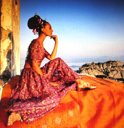 Marisa Berenson gazing at the distance on a mountain top retreat, love the golden shoes...