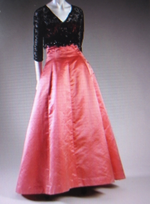 A very classic design with black lace on an A-line skirt. This style has become a favourite silhouette of Bridal design.