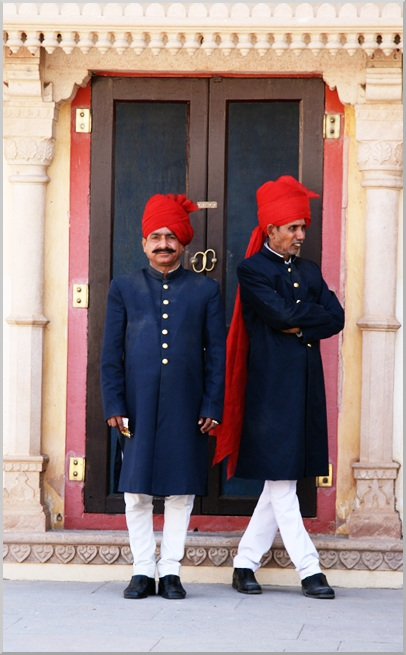 The guards in their colorful uniforms.