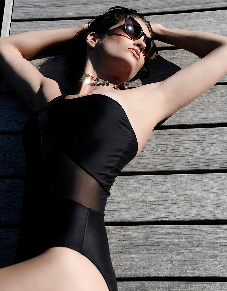 lady in bl swimsuit golden necklace.jpg