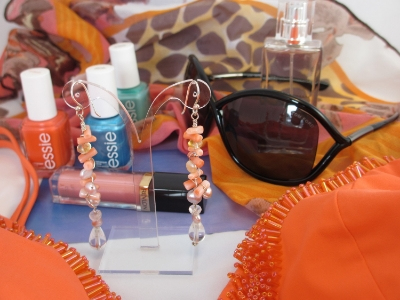 My favorite Look for an Island escape in coral, the bathing suit is by Marian Mehlhorn, with ear jewelry in pink coral by Jasmin blu Jewelry.