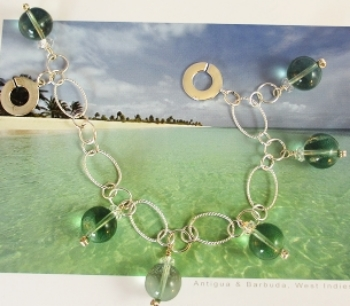 These Fluorite beads have the color of and Emerald Lagoon glistening in the sun light.