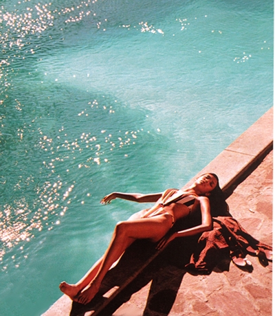 At the edge of the pool the sunlight reflecting, daydreaming...