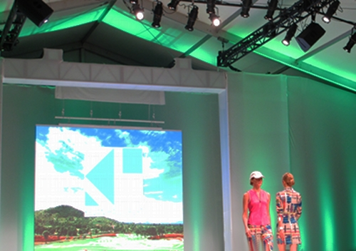 Models presenting the Kevan Hall Sports golf collection.