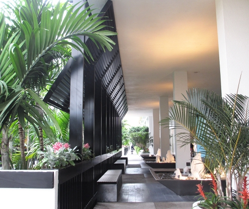 "The walkways at the ""Shops at Bal Harbour"" invite you to stroll along the tropical garden setting."
