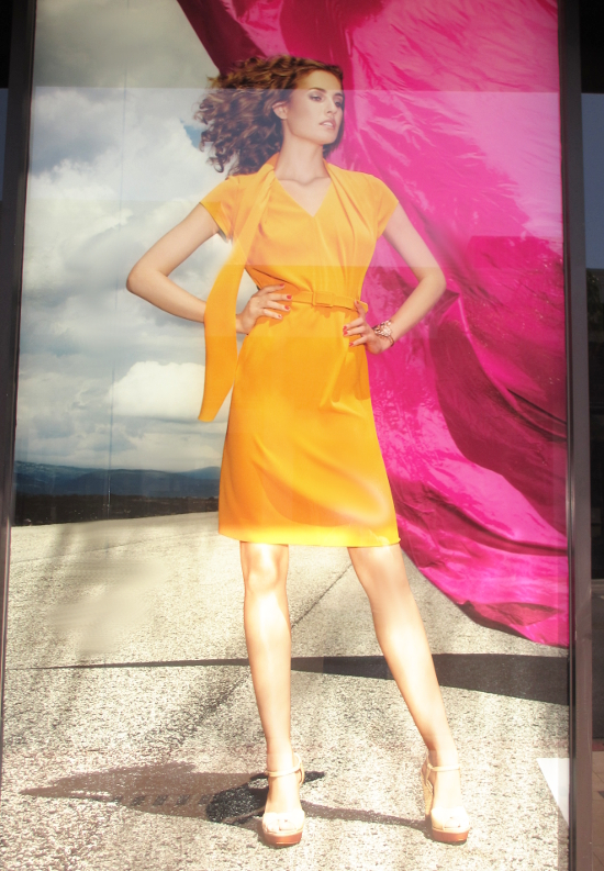 Escada fun day style in orange silk. Like the sleek design and popping color.