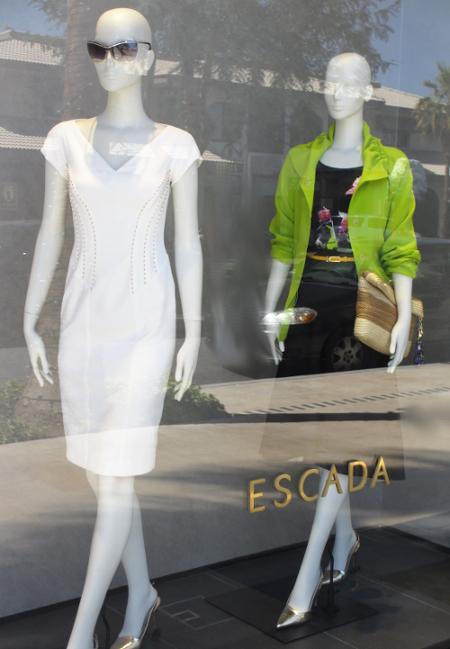 Escada El Paseo window, sleek silhouette white dress.