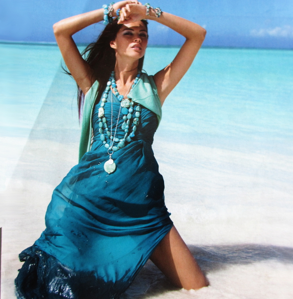Just like me standing in the waves on Black's Beach, Antigua bejeweled with Turquoise jewelry in aqua waters.