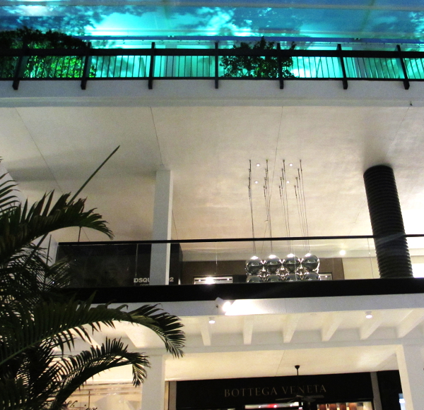 The kinetic steel sculpture at the Shops at Bal Harbour when evening falls. Magical!