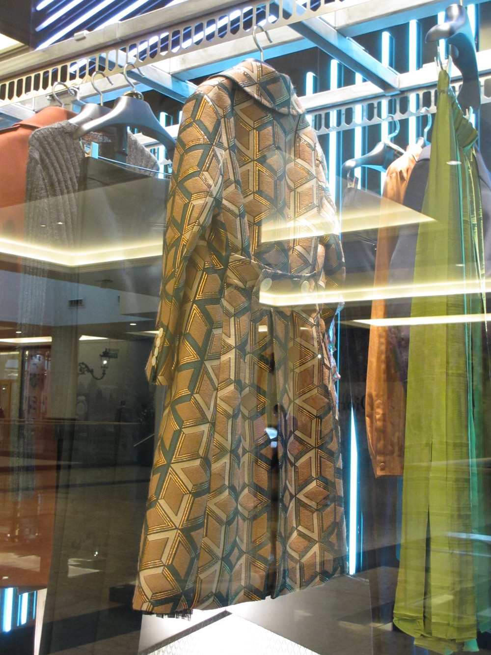 The dry-cleaners carousel with a 70s inspired coat.