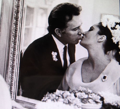on their wedding day, a kiss, the Emerald brooch