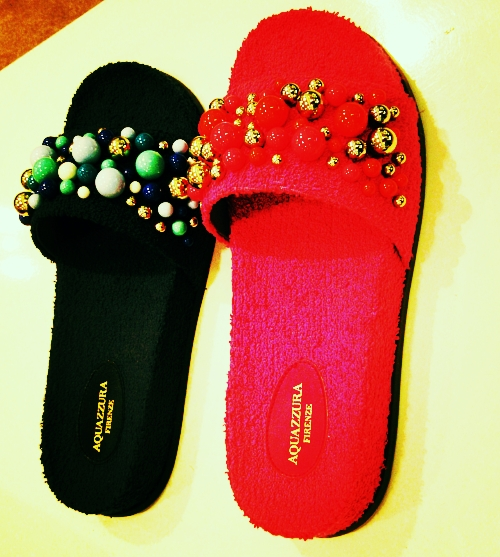 - Fuzzy slides with golden pearls