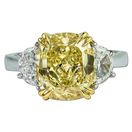 Stunning Fancy Yellow cushion cut diamond ring with two half moon shaped diamonds.
