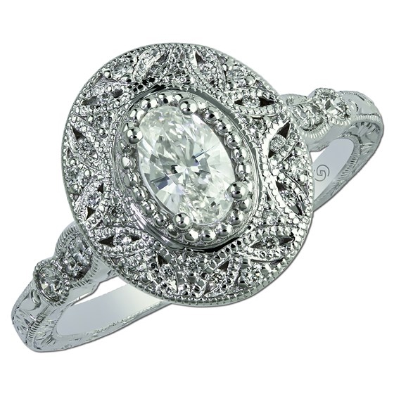 Oval cut halo diamond Just Beginning engagement ring. A single row and a frame of round diamonds highlight an oval cut diamond.
