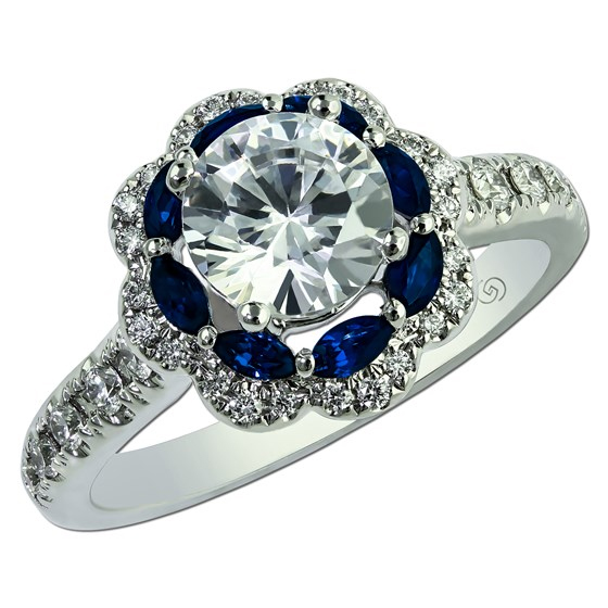 Unique marquise cut sapphire and round diamond halo semi-mount engagement ring.