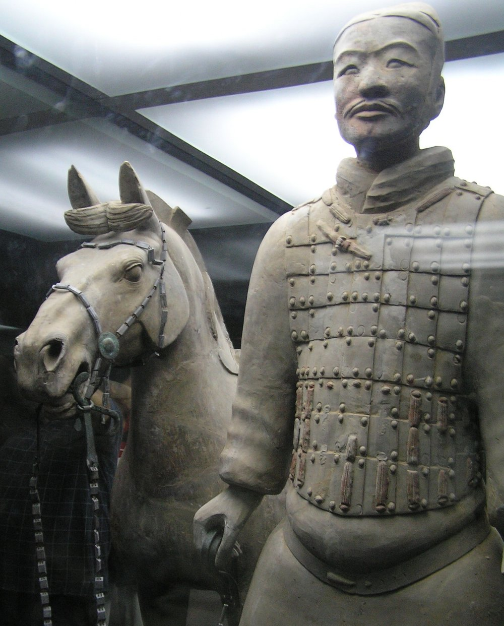 A terracotta warrior got his thumb broken off in an exhibition in the US- is that such a disaster as the Chinese authorities say judging from that smile? The horse is saying nothing.