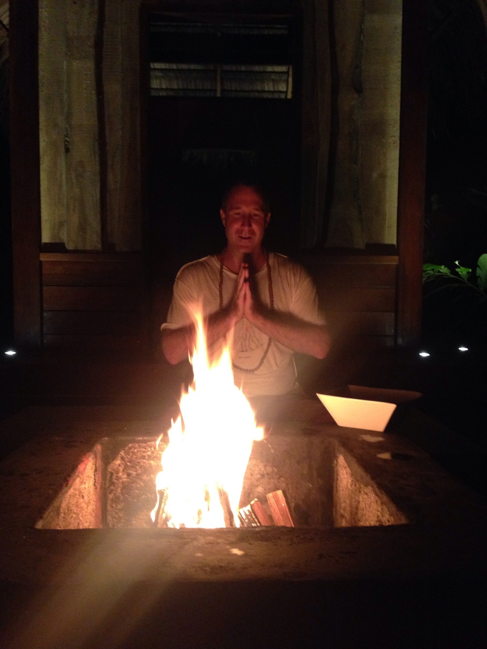 Here is our dear yogi Aaron in a photo from yesterday. It was Dan and Casey's last night here and we had an Intention Ceremony where we, in celebration of the New Year and Winter Solstice, put our intentions into the flame while chanting. It was quite powerful.  Namaste.